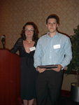 Ivan Chekerev receiving the Hypercude Scholar award.  Presented by Dr. Julie Harmon.