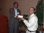 Glenn Harris receiving the Analytical Chemistry award.  Presented by Dr. Abdul Malik.