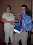 John Magulick receiving the Biochemistry Award.  Presented by Dr. Ellen Verdel.