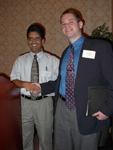 Christopher Corcoran receiving the Phi Lambda Upsilon Award.  Presented by Dr. Kirpal Bisth.