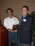 Christopher Corcoran receiving the Outstanding B.S. Chemistry Major award.  Presented by Dr. Kenneth Caswell.