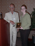 Casey Gooden receiving the T.C. Owen Undergraduate Research Award.  Presented by Dr. Terence Owen.