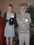 Dr. Denise Manker receiving the Outstanding Alumni Award.  Dr. Bill Baker presenting.