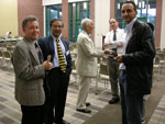 Chemistry Professors conversing (left to right): Dr. Potter, Dr. Malik, Dr. Owen, Dr. Turos, and Dr. Eddaoudi.
