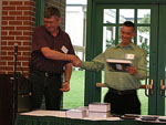Matthew Chandler receiving the Physical Chemistry Award.  Presented by Dr. Randy Larsen.