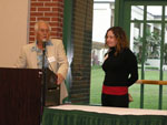 Lauren 0'Donnell receiving the T.C. Owen Undergraduate Research Award.  Presented by Dr. Terence Owen.