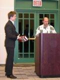 Joshua Eberhard receives the Biochemistry Award. Presented by Dr. David Merkler.