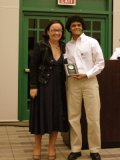 Shamik Dwivedi receives the Outstanding Biomedical Science Award.  Presented by Dr. Julie Harmon.