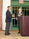 Dr. Dean Martin presents the Outstanding Alumni Award to Dr. Bruce Anderson.