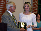 Dr. Stanko presents the Outstanding Alumni Award to Dr. Julia Burdge.