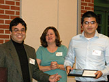 Dr. Edwin Rivera presents the Hypercube Scholar award to Mario Martinez.
