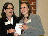 Dr. Patricia Muisener presents the Outstanding B.S. Chemistry Major award to Karin Thatcher.